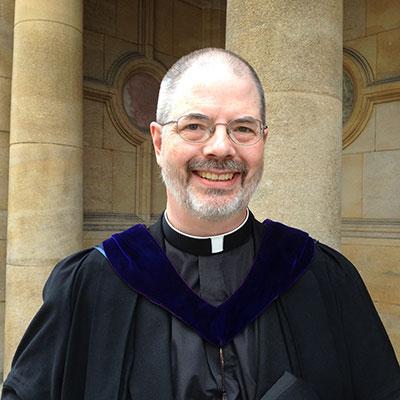 The Revd Dr A. K. M. Adam